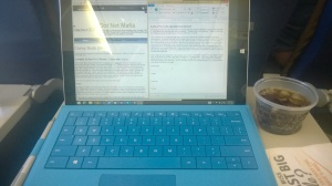 Surface Pro 3 sitting on a tray table