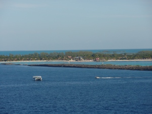 Boats and watercraft greet the cruise ship as it pulls into Castaway Cay