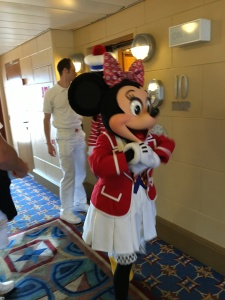 Minnie Mouse greeting people