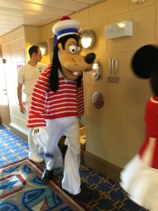 Goofy coming out of the elevator on Deck 10 Midship