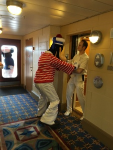 Goofy shoving a cast member back into the elevator