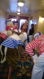 Disney characters getting warmed up for the Sail Away party on the Disney Wonder.